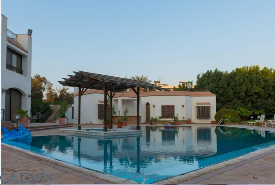 Villa for Sale in Mansoreya with Private Garden & Swimming Pool